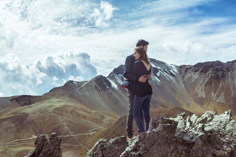 couple-posing-on-mountain-for-love-hug